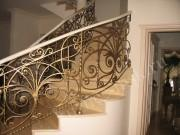 Ковка перила на радиусной лестнице